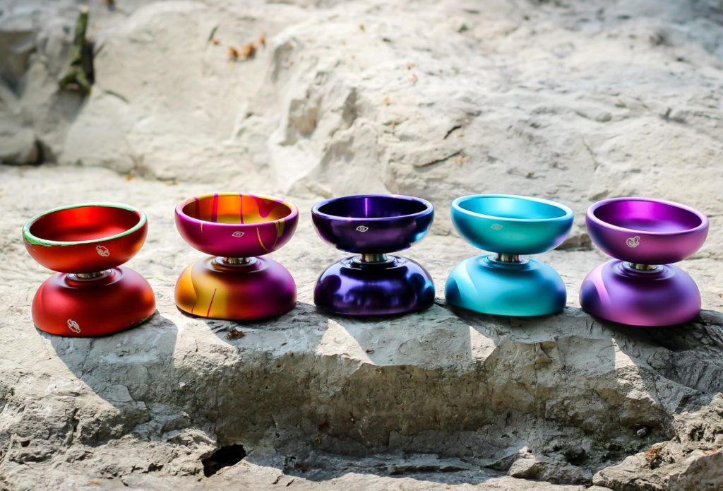 photo of five mk1 contact yoyos sitting on a rock